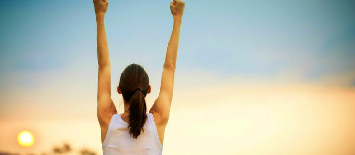 Happy-woman-fist-air-celebrating-empowered-women-ss-feature