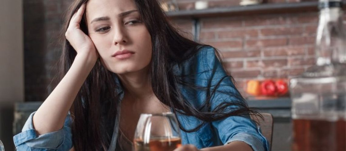 young-woman-looking-at-bottle-768
